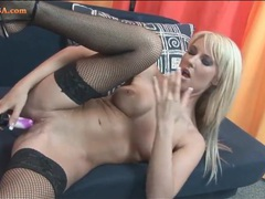 Chick in fishnets fucks a toy into her hot hole clip