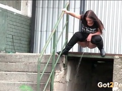 Big ass girl in leather boots pees outdoors tubes