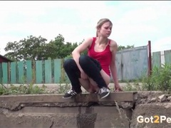 Skinny girl empties her entire bladder outdoors videos