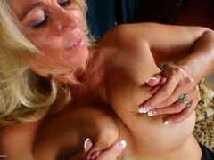 Pretty blonde mature babe plays with her big tits videos