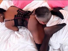 Hot black chick in a full lingerie set gives a footjob movies at sgirls.net