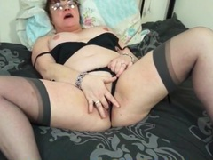 Mature seductress in stockings and a garter belt videos