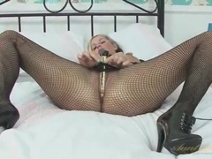 Babe pulls down her fishnet pantyhose to masturbate videos
