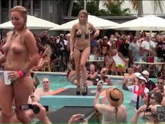 Topless babes in bikini bottoms dance at the pool videos