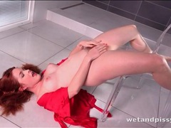 Redhead unties her sexy robe to piss erotically videos