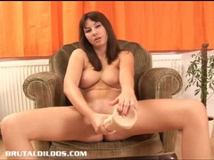 Natural brunette fills her wet pussy with a huge dildo tubes