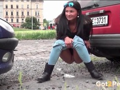Girl squats between parked cars to pee videos