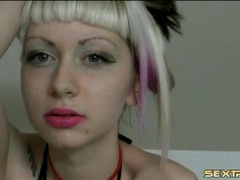 Cam girl puts on pretty pink lipstick and teases movies at find-best-videos.com