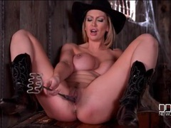 Cowgirl shoves a cattle brand in her pussy videos