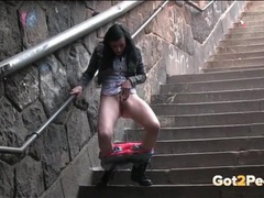 Jeans and panties girl pees on the public stairs videos