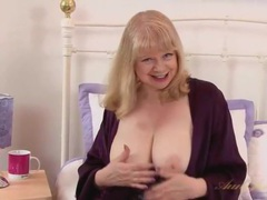 Purple lingerie is wondrous on the busty granny videos