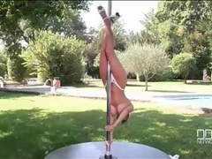 Pole dancing babe with big tits works outdoors tubes