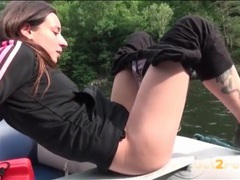 Pretty girl on a boat pisses into the lake videos