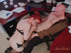 Naughty redheaded secretary in lingerie blows her boss videos