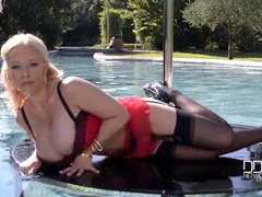Massive tits milf wears lingerie in the pool movies at lingerie-mania.com