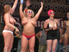 Babes on stage flash their tits for a crowd of bikers tubes