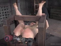 Toy machine anally pounds a big ass girl in bondage videos