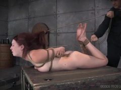 Real pain for a submissive redhead in rope bondage videos