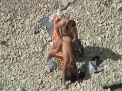 Couple fucking on the beach spied on movies