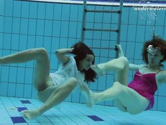 Cuties in lingerie jump in the pool for a swim videos