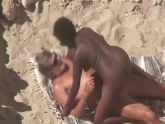 Interracial couple caught fucking on the beach videos