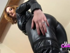 Skintight leather costume on a dazzling busty redhead movies at find-best-babes.com