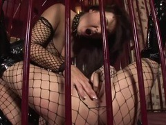 Lesbians in a cage fuck in fishnets and boots videos