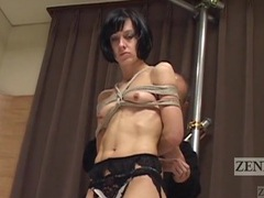 Skinny girl stands still for erotic shibari play videos