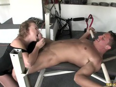 Slut in a black dress blows a muscular guy tubes