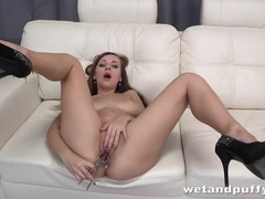 Long legged girl in high heels has fun with toys videos