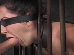 Chained slave in a cage opens her mouth for face fucking videos