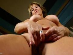 Perky fake tits are fantastic on a masturbating milf movies at kilogirls.com