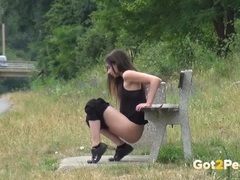 Pissing on the side of the road with a brunette videos
