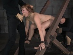 Cocks pound the redhead in naughty bondage videos