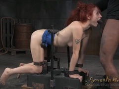 Slut in a bondage device used by two guys videos