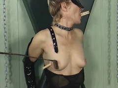 Clothes pins on the tits of a girl in black latex movies at sgirls.net