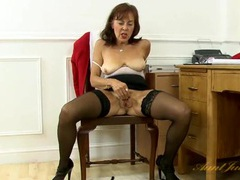 Secretary in black stockings rubs her old cunt videos