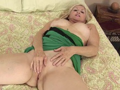 Cute blonde mature babe with big tits rubs her clit videos