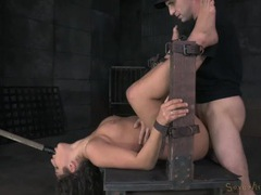 Babe in a bondage device takes a hard pounding videos