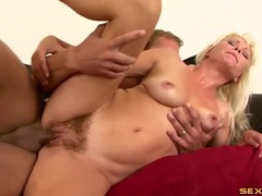 Blonde with a big bush sits on his stiff dick movies at lingerie-mania.com