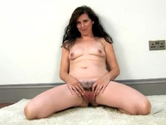 Old babe with a thick bush spreads her pussy lips videos
