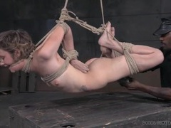 Skinny girl in a rope bondage suspension suffers abuse videos