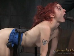 Slut strapped into a bondage device takes cock videos