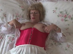 Old babe in a lovely corset fondles her tits videos