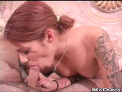 Redhead with lovely tattooed arms sucks dick videos
