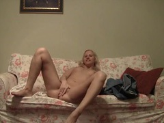 Sweet blonde sets up her camera and strips solo movies
