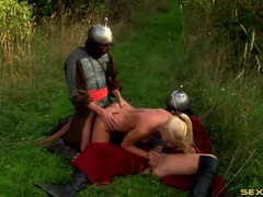 Knights double penetrate a slutty blonde in the grass videos
