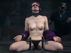 Collared and bound redheaded beauty in a dungeon videos