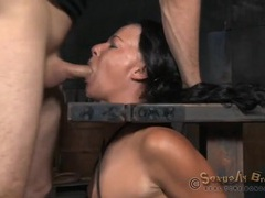 Weights hang off the nipples of a bound slut videos