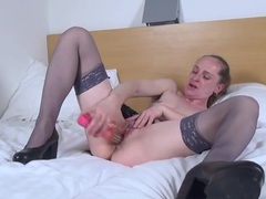Pierced solo milf in stockings has fun with a toy movies at sgirls.net
